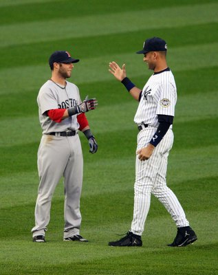 NEW YORK - MAY 05:  Derek Jeter #2 of the New York Yankees talks with Dustin Pedroia #15 of the Boston Red Sox prior to their game on May 5, 2009 at Yankee Stadium in the Bronx borough of New York City. The Red Sox defeated the Yankees 7-3. (Photo by Jim
