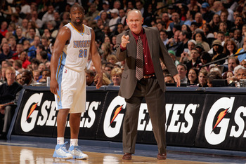 DENVER, CO - FEBRUARY 24:  Head coach George Karl directs Raymond Felton #20 of the Denver Nuggets against the Boston Celtics during NBA action at the Pepsi Center on February 24, 2011 in Denver, Colorado. The Nuggets defeated the Celtics 89-75. NOTE TO U