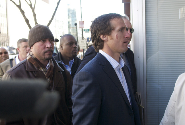 WASHINGTON, DC - MARCH 03:  New Orleans Saints' Drew Brees (R), a member of the NFL Players Association executive committee, makes his way into the Federal Mediation and Conciliation Service building for the NFL labor negotiations on March 3, 2011 in Wash