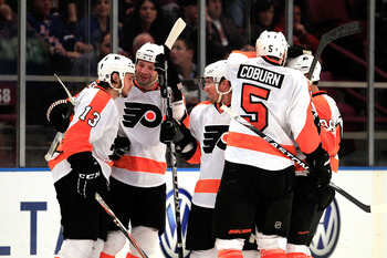 NEW YORK, NY - FEBRUARY 20:  Daniel Carcillo #13 of the Philadelpia Flyers is congratulated by his teammates for his second period goal against the New York Rangers at Madison Square Garden on February 20, 2011 in New York City. The Flyers defeated the Ra