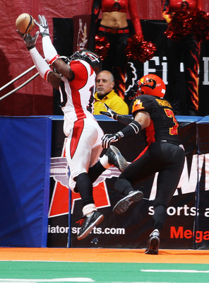 UNIONDALE, NY - APRIL 26:  Billy Parker #7 of the New York Dragons watches Otis Amey #10 of the Cleveland Gladiators unable hold onto the ball on April 26, 2008 at Nassau Coliseum in Uniondale, New York.  Dragons defeat Gladiators 56-39.  (Photo by Mike S