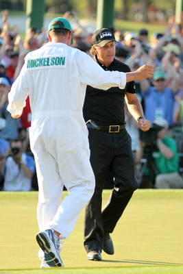 AUGUSTA, GA - APRIL 11:  Phil Mickelson hugs his caddie Jim Mackay after his three-stroke victory after winning the 2010 Masters Tournament at Augusta National Golf Club on April 11, 2010 in Augusta, Georgia.  (Photo by Jamie Squire/Getty Images)