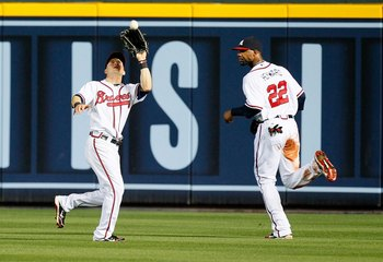 ATLANTA - MAY 28:  Nate McClouth #24 and Jason Heyward #22 of the Atlanta Braves against the Pittsburgh Pirates at Turner Field on May 28, 2010 in Atlanta, Georgia.  (Photo by Kevin C. Cox/Getty Images)