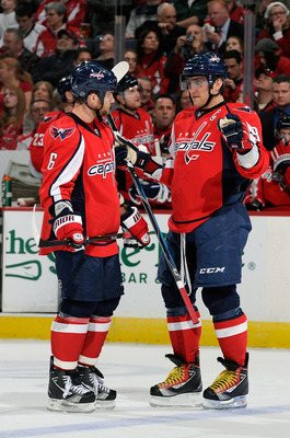 WASHINGTON, DC - MARCH 01:  Dennis Wideman #6 and Alex Ovechkin #8 of the Washington Capitals talk during the game against the New York Islanders at the Verizon Center on March 1, 2011 in Washington, DC.  (Photo by Greg Fiume/Getty Images)
