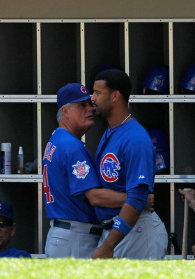 CHICAGO - JUNE 25: Manager Lou Piniella #41 of the Chicago Cubs talks with Derrek Lee #25 after Lee had a confrontation with starting pitcher Carlos Zambrano in the dugout during a game against the Chicago White Sox at U.S. Cellular Field on June 25, 2010