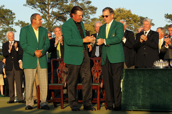 AUGUSTA, GA - APRIL 11:  Augusta National Chairman William 'Billy' Porter Payne (R) congratulates Phil Mickelson (C) on his three-stroke victory during the green jacket presentation as Angel Cabrera of Argentina looks on after the final round of the 2010