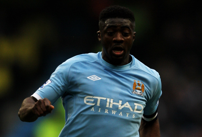 MANCHESTER, ENGLAND - FEBRUARY 20:  Kolo Toure of Manchester City on the ball during the FA Cup sponsored by E.On 4th Round replay match between Manchester City and Notts County at City of Manchester Stadium on February 20, 2011 in Manchester, England.  (
