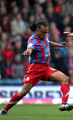 LONDON, ENGLAND - OCTOBER 2 :   Edgar Davids of Crystal Palace wins the ball from Adel Taarabt of Queens Park Rangers during the npower Championship match between Crystal Palace and Queens Park Rangers at Selhurst Park on October 2, 2010 in London, Englan