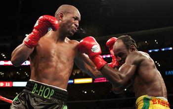 LOS ANGELES, CA - FEBRUARY 19:  Bernard Hopkins (L) lands a left hook on Howard Eastman in the middleweight championship fight at Staples Center on February 19, 2005 in Los Angeles, California.  (Photo by Nick Laham/Getty Images)