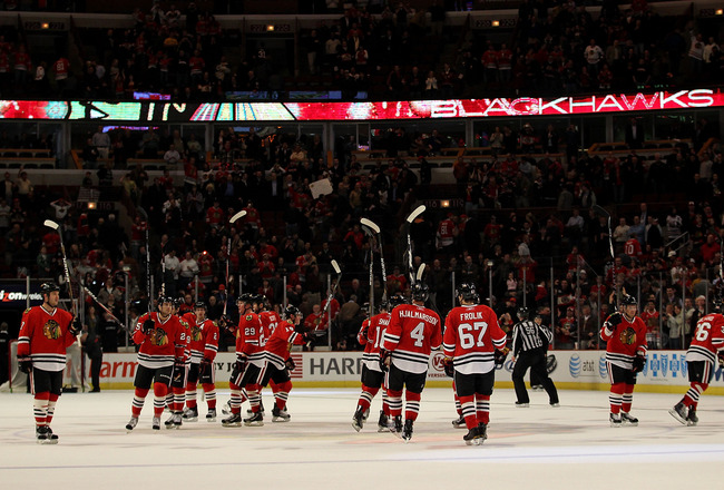 CHICAGO, IL - FEBRUARY 16: Members of the Chicago Blackhawks salute the crowd after a win over the Minnesota Wild at the United Center on February 16, 2011 in Chicago, Illinois. The Blackhawks defeated the Wild 3-1. (Photo by Jonathan Daniel/Getty Images)