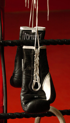 NEW ZEALAND - FEBRUARY 08:  Stock Photography. Generic Boxing Image. Everlast boxing gloves photographed photographed hanging from the ropes on a boxing ring.  (Photo by Ross Land/Getty Images)