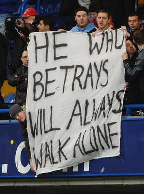 LONDON, ENGLAND - FEBRUARY 06:  Liverpool fans hold a banner showing their feelings towards Fernando Torres during the Barclays Premier League match between Chelsea and Liverpool at Stamford Bridge on February 6, 2011 in London, England.  (Photo by Lauren