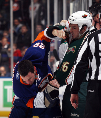 UNIONDALE, NY - MARCH 02: Zenon Konopka #28 of the New York Islanders fights with Brad Staubitz #16 of the Minnesota Wild at the Nassau Coliseum on March 2, 2011 in Uniondale, New York. The Islanders defeated the Wild 4-1.  (Photo by Bruce Bennett/Getty I