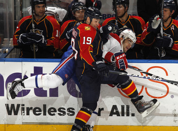 SUNRISE, FL - MARCH 3: Max Pacioretty #67 of the Montreal Canadiens is checked by Marty Reasoner #19 of the Florida Panthers on March 3, 2011 at the BankAtlantic Center in Sunrise, Florida. The Canadiens defeated the Panthers 4-0. (Photo by Joel Auerbach/