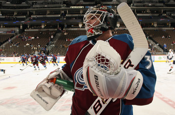 DENVER, CO - FEBRUARY 23:  Goalie Brian Elliott #30 of the Colorado Avalanche pauses for a drink as he warms up prior to facing the Edmonton Oilers at the Pepsi Center on February 23, 2011 in Denver, Colorado. The Oilers defeated the Avalanmche 5-1.  (Pho