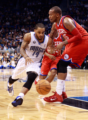 ORLANDO, FL - DECEMBER 18:  Jameer Nelson #14 of the Orlando Magic drives against Marreese Speights #16 of the Philadelphia 76ers during the game at Amway Arena on December 18, 2010 in Orlando, Florida.  NOTE TO USER: User expressly acknowledges and agree