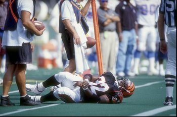 6 Sep 1998:  Running back Ki-Jana Carter #32 of the Cincinnati Bengals lies injured on the field during the game against the Tennessee Oilers at Cinergy Field in Cincinnati, Ohio. The Oilers defeated the Bengals 23-14. Mandatory Credit: Mark Lyons  /Allsp