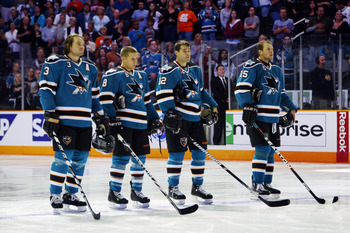 SAN JOSE, CA - SEPTEMBER 25: Douglas Murray #3, Joe Pavelski #8, Patrick Marleau #12, and Dany Heatley #15 of the San Jose Sharks stop for the national anthem before a preseason split-squad game against the Phoenix Coyotes at HP Pavilion on September 25,