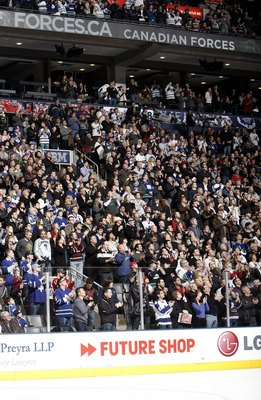 TORONTO - JANUARY 30: 18,000+ fans give a standing ovation to the Armed Forces personelle in attendance during the Toronto Maple Leafs vs The Vancouver Canucks game January 30, 2010 at the Air Canada Centre in Toronto, Ontario, Canada. (Photo by Abelimage