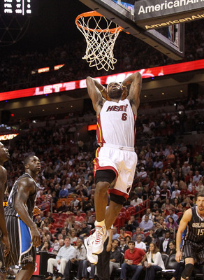MIAMI, FL - MARCH 03:  LeBron James #6 of the Miami Heat dunks the ball during a game against the Orlando Magic at American Airlines Arena on March 3, 2011 in Miami, Florida. NOTE TO USER: User expressly acknowledges and agrees that, by downloading and/or