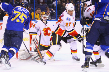 ST. LOUIS, MO - MARCH 1: Miikka Kiprusoff #34 of the Calgary Flames looks to make a save against the St. Louis Blues at the Scottrade Center on March 1, 2011 in St. Louis, Missouri.  (Photo by Dilip Vishwanat/Getty Images)
