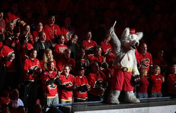 CALGARY, AB - APRIL 27: The Calgary Flames mascot 'Harvey the Hound'  leads fans in a cheer before the Flames played the Chicago Blackhawks  in Game Six of the Western Conference Quarterfinals of the 2009 Stanley Cup Playoffs on April 27, 2009 at the Peng