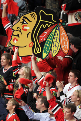 CHICAGO - JUNE 06:  Fans of the Chicago Blackhawks support their team in Game Five of the 2010 NHL Stanley Cup Final against the Philadelphia Flyers at the United Center on June 6, 2010 in Chicago, Illinois.  (Photo by Andre Ringuette/Getty Images)