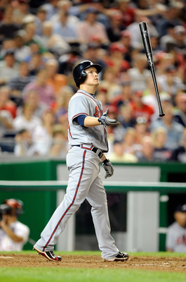 WASHINGTON - SEPTEMBER 24:  Nate McLouth #24 of the Atlanta Braves tosses his bat after striking out against the Washington Nationals at Nationals Park on September 24, 2010 in Washington, DC.  (Photo by Greg Fiume/Getty Images)