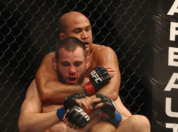 SYDNEY, AUSTRALIA - FEBRUARY 27:  BJ Penn of the USA attempts to choke Jon Fitch of the USA during their welterweight bout part of UFC 127 at Acer Arena on February 27, 2011 in Sydney, Australia.  (Photo by Mark Kolbe/Getty Images)