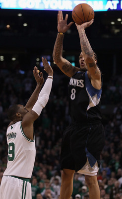 BOSTON, MA - JANUARY 03:  Michael Beasley #8 of the Minnesota Timberwolves takes the last shot of the game as Rajon Rondo #9 of the Boston Celtics defends on January 3, 2011 at the TD Garden in Boston, Massachusetts. The Celtics defeated the Timberwolves