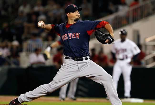 FORT MYERS, FL - FEBRUARY 27:  Pitcher Josh Beckett #19 of the Boston Red Sox pitches against the Minnesota Twins during a Grapefruit League Spring Training Game at Hammond Stadium on February 27, 2011 in Fort Myers, Florida.  (Photo by J. Meric/Getty Ima