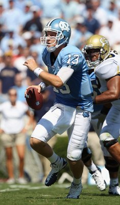 CHAPEL HILL, NC - SEPTEMBER 18:  T.J. Yates #13 of the North Carolina Tar Heels against the Georgia Tech Yellow Jackets during their game at Kenan Stadium on September 18, 2010 in Chapel Hill, North Carolina.  (Photo by Streeter Lecka/Getty Images)