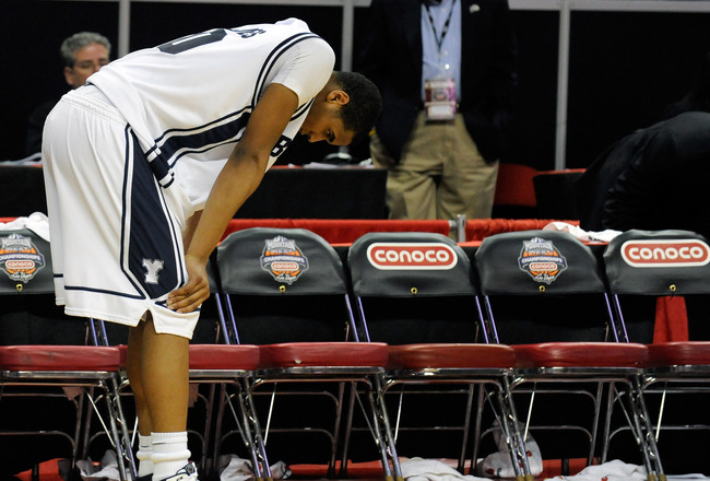 LAS VEGAS - MARCH 12:  Brandon Davies # 0 of the Brigham Young University Cougars is dejected after the team's 70-66 loss to the UNLV Rebels in a semifinal game of the Conoco Mountain West Conference Basketball tournament at the Thomas & Mack Center March
