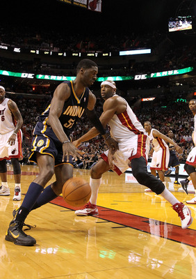 MIAMI, FL - FEBRUARY 08:  Roy Hibbert #55 of the Indiana Pacers drives around Eric Dampier #25 of the Miami Heat during a game at American Airlines Arena on February 8, 2011 in Miami, Florida. NOTE TO USER: User expressly acknowledges and agrees that, by