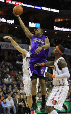 CHARLOTTE, NC - FEBRUARY 25:  Marcus Thornton #23 of the Sacramento Kings drives to the basket on Stephen Jackson #1 of the Charlotte Bobcats during their game at Time Warner Cable Arena on February 25, 2011 in Charlotte, North Carolina. NOTE TO USER: Use