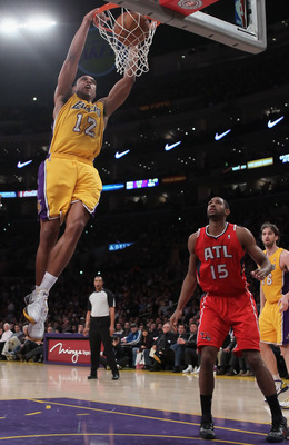 LOS ANGELES, CA - FEBRUARY 22:  Shannon Brown #12 of the Los Angeles Lakers drives to the basket past Al Horford #15 of the Atlanta Hawks for a dunk in the first half at Staples Center on February 22, 2011 in Los Angeles, California. The Lakers defeated t