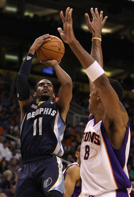 PHOENIX - DECEMBER 08:  Mike Conley #11 of the Memphis Grizzlies puts up a shot against the Phoenix Suns during the NBA game at US Airways Center on December 8, 2010 in Phoenix, Arizona. NOTE TO USER: User expressly acknowledges and agrees that, by downlo