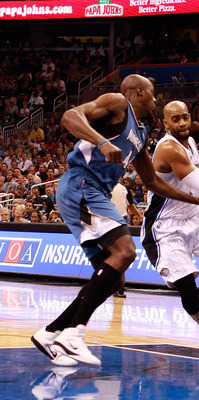 ORLANDO, FL - NOVEMBER 03:  Vince Carter #15 of the Orlando Magic drives against Anthony Tolliver #44 of the Minnesota Timberwolves during the game at Amway Arena on November 3, 2010 in Orlando, Florida.  NOTE TO USER: User expressly acknowledges and agre