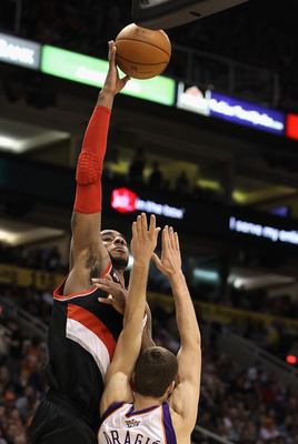 PHOENIX, AZ - JANUARY 14:  LaMarcus Aldridge #12 of the Portland Trail Blazers puts up a shot over Goran Dragic #2 of the Phoenix Suns during the NBA game at US Airways Center on January 14, 2011 in Phoenix, Arizona.  NOTE TO USER: User expressly acknowle