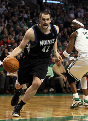 BOSTON, MA - JANUARY 03:  Kevin Love #42 of the Minnesota Timberwolves drives around Jermaine O'Neal #7 of the Boston Celtics on January 3, 2011 at the TD Garden in Boston, Massachusetts. The Celtics defeated the Timberwolves 96-93. NOTE TO USER: User exp