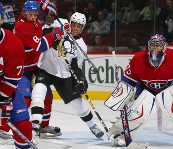 MONTREAL, CANADA - SEPTEMBER 17:  Ryan Malone #12 of the Pittsburgh Penguins fights for position with Michael Komisarek #8 of the Montreal Canadiens out front of his goaltender Yann Danis #75 during a pre-season game on September 17, 2007 at the Bell Cent