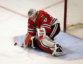 CHICAGO, IL - FEBRUARY 27: Corey Crawford #50 of the Chicago Blackhawks makes a save in the shootout against the Phoenix Coyotes at the United Center on February 27, 2011 in Chicago, Illinois. The Blackhawks defeated the Coyotes 4-3 in a shootout.  (Photo
