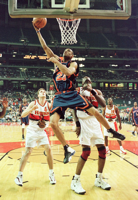 20 May 1999:  Allan Houston #20 of the New York Knicks soars to the basket against Chris Crawford #4 and Dikembe Mutombo #55 of the Atlanta Hawks during game 2 of the NBA Eastern Conference semifinals at the Georgia Dome in Atlanta, Georgia. Mandatory Cre