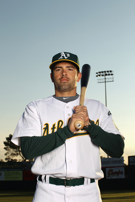 PHOENIX, AZ - FEBRUARY 24:  David DeJesus #12 of the Oakland Athletics poses for a portrait during media photo day at Phoenix Municipal Stadium on February 24, 2011 in Phoenix, Arizona.  (Photo by Ezra Shaw/Getty Images)