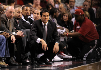 MIAMI, FL - FEBRUARY 25:  Head coach Erik Spoelstra of the Miami Heat looks on during a game against the Washington Wizards at American Airlines Arena on February 25, 2011 in Miami, Florida. NOTE TO USER: User expressly acknowledges and agrees that, by do