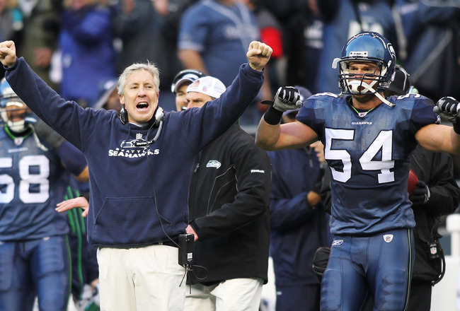 SEATTLE, WA - JANUARY 08: Head coach Pete Carroll and Will Herring #54 of the Seattle Seahawks celebrate a fourth down stop by the Seahawks in the third quarter against the New Orleans Saints during the 2011 NFC wild-card playoff game at Qwest Field on Ja