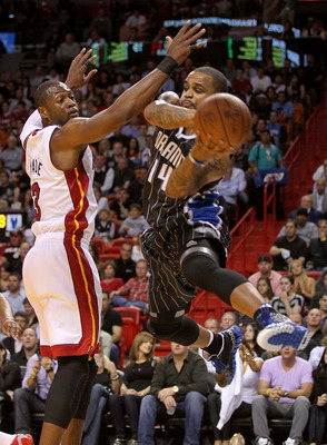 MIAMI, FL - MARCH 03:  Jameer Nelson #14 of the Orlando Magic passes around Dwyane Wade #3 of the Miami Heat during a game at American Airlines Arena on March 3, 2011 in Miami, Florida. NOTE TO USER: User expressly acknowledges and agrees that, by downloa