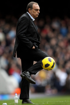 LONDON, ENGLAND - FEBRUARY 27:  Avram Grant manager of West Ham kicks the ball during the Barclays Premier League match between West Ham United and Liverpool at the Boleyn Ground on February 27, 2011 in London, England.  (Photo by Scott Heavey/Getty Image