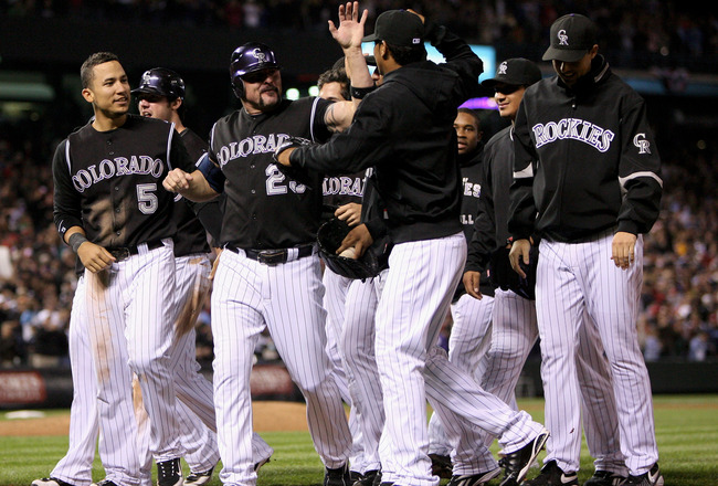 DENVER - SEPTEMBER 25:  Jason Giambi #23 of the Colorado Rockies celebrates with his teammates after defeating the St. Louis Cardinals at Coors Field on September 25, 2009 in Denver, Colorado. Giambi had a pinch hit single in the ninth inning as the Rocki