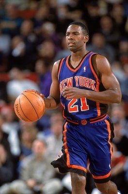 14 Nov 2000:  Charlie Ward #21 of the New York Knicks dribbles the ball during the game against the Seattle SuperSonics at Key Arena in Seattle, Washington.  The SuperSonics defeated the Knicks 96-75.   NOTE TO USER: It is expressly understood that the on